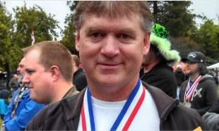 John Julum, wearing one of three medals Big Block won at the 2014 Washington Brewers Festival