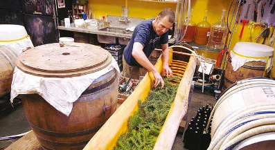 Paul Arney readies spruce tips at Bend's amazing The Ale Apothecary
